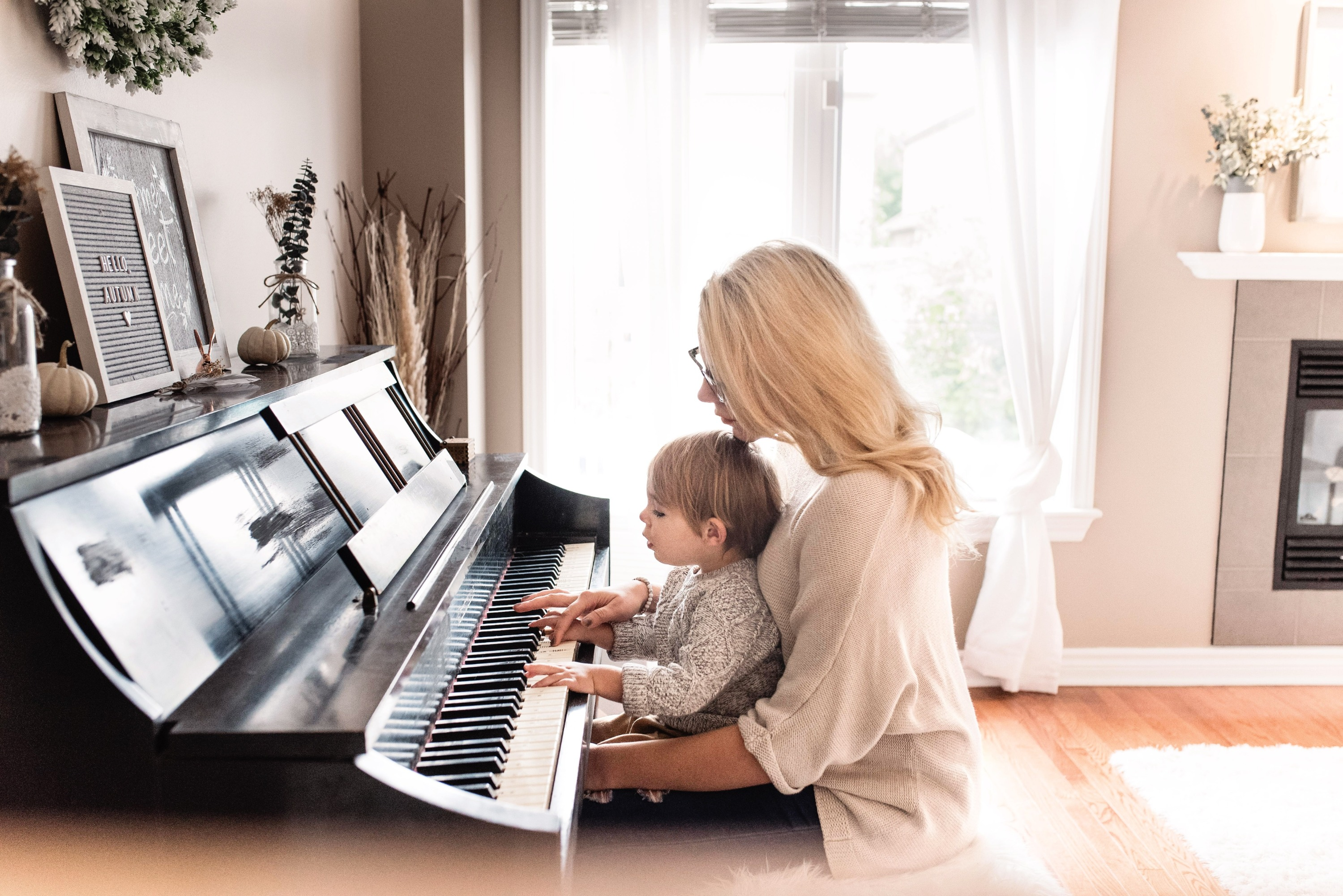 Woman and child playing the piano