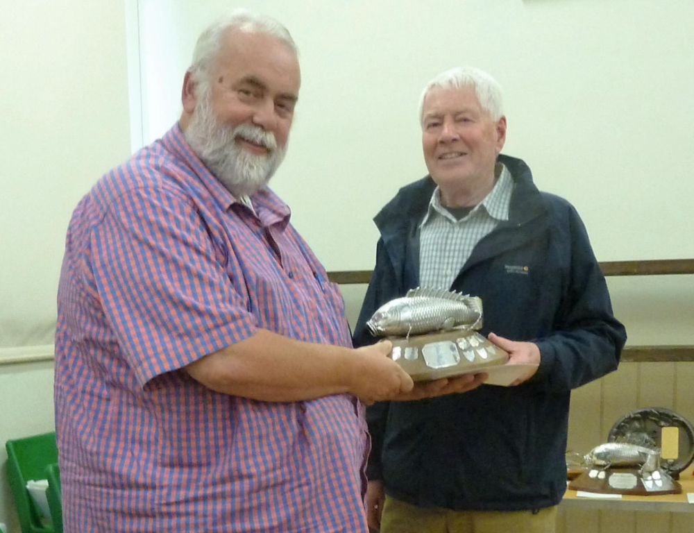 Peter Lloyd (right) presents Sherridan Moores (NGPS) with the magnificent silver trophy for his Best in Show Lionhead goldfish.