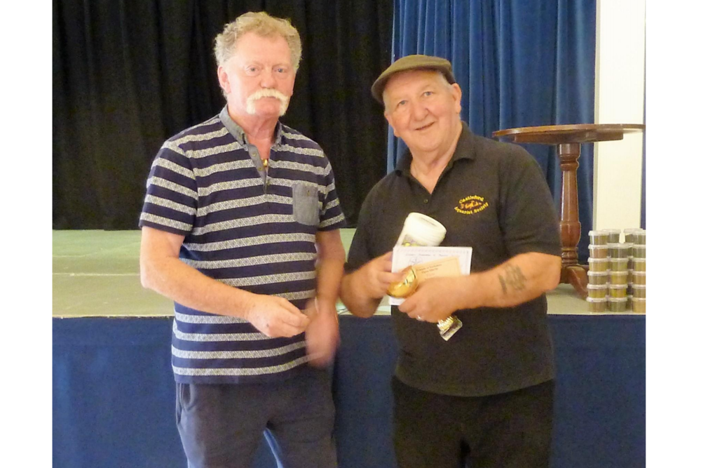 Roy Blackburn (right) from Castleford AS receives the Best Exhibit trophy.