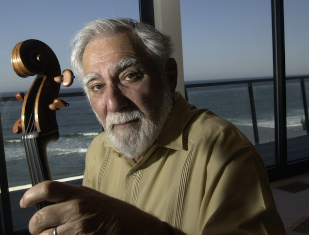 Herbert Axelrod, pictured with another of his great passions — the violin. Image: Barcroft Media.