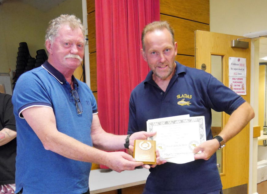 Roy collects his Award from Steve Jones of YAAS.