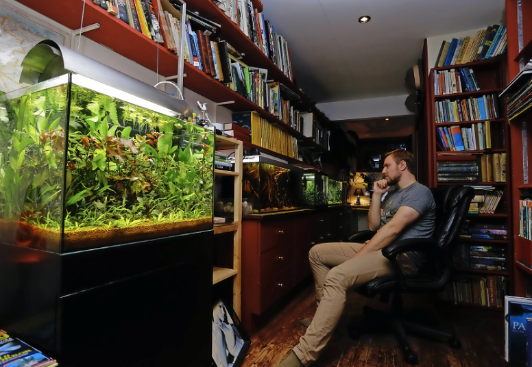 Tai at home with his tanks, many of which have been inspired by his trips around the world.