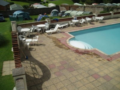 The outdoor pool is near the camping area