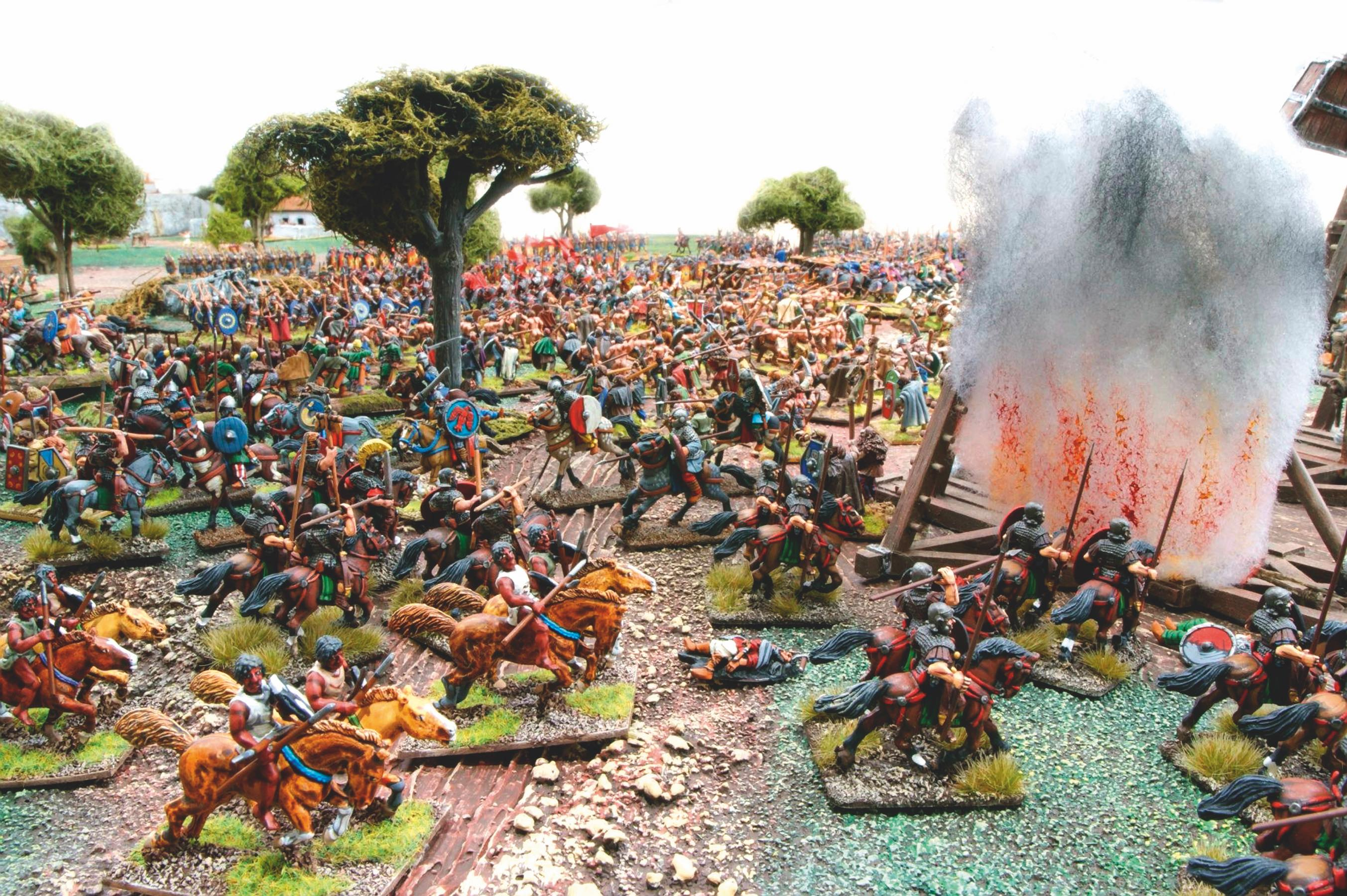 In the chaos of battle some Roman cavalry break through the Visigoth lines and set fire to the siege engines.
