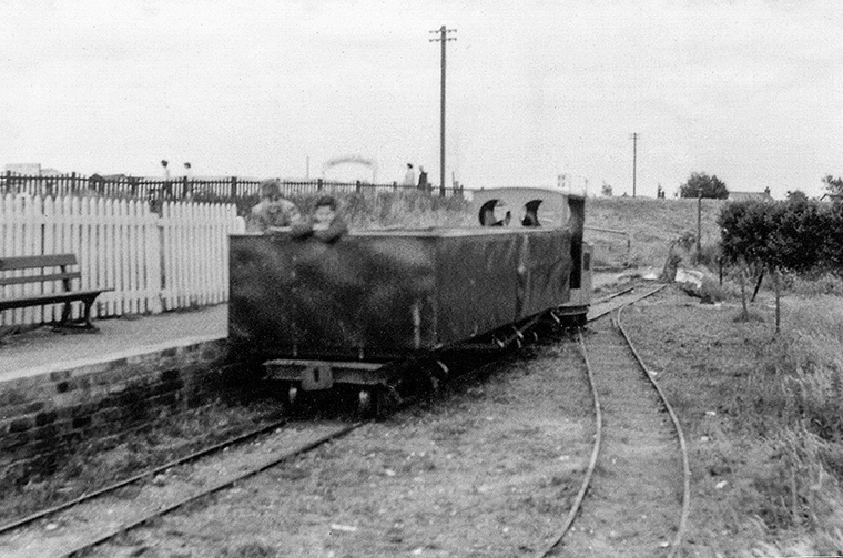 Open Coach: A full train awaits departure form the original North Sea Lane station at Humberston behind LCLR's Loco No. 1 ((Motor Rail 'Simplex' 3991 of 1926).