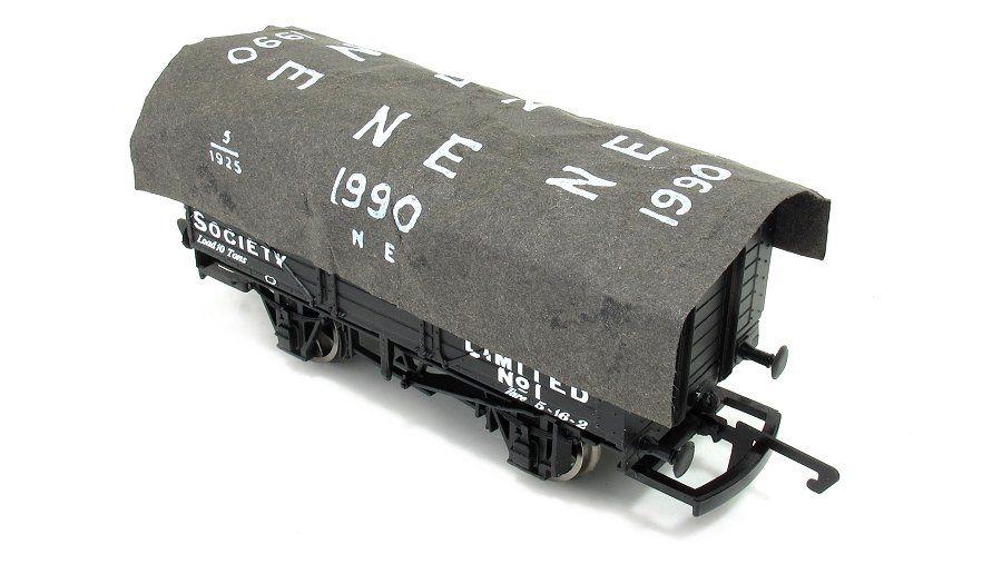 Glue tarpaulin onto model railway wagon