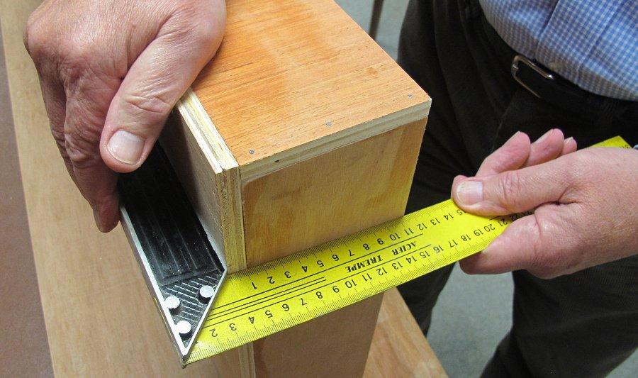 carpenters square on model railway baseboard