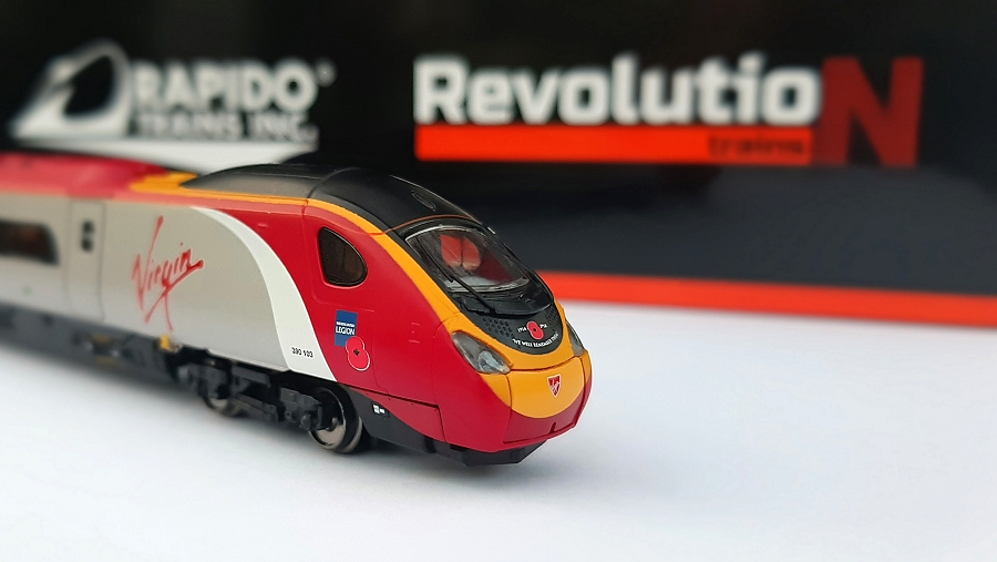 "Revolution/Rapido Trains model of 390103 Virgin Hero in N gauge featuring RBL branding and ""We Will Remember Them"" lettering across the nose."